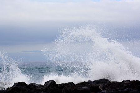 Huge wave splash over rock coast photo