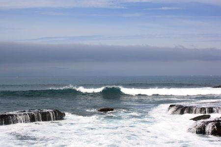 Wave splash over coast photo