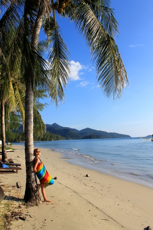 Woman enjoy a moment on tropical beach photo