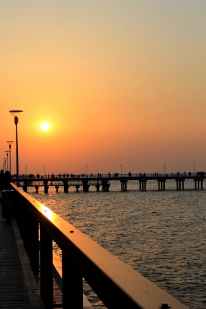 jetty into sunset Stock Photo - 13612743