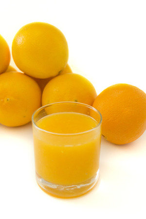 sourness: Fresh oranges and juice isolated over white background