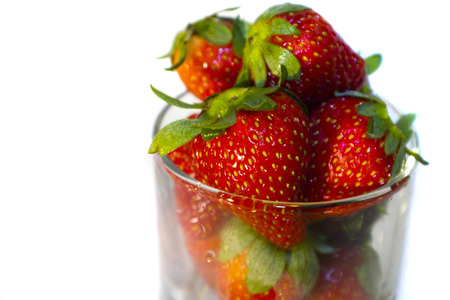 sourness: Fresh strawberries in a glass cup