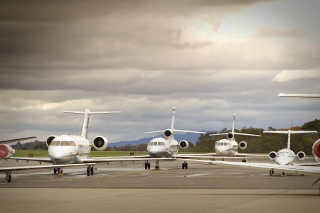 Business aircraft parked on an airport Editorial