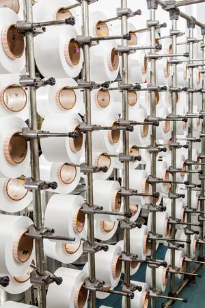 the textile industry: Textile industry weaving and warping machine - production Stock Photo