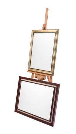 Two white painter canvas in frame on wooden easel isolated on white