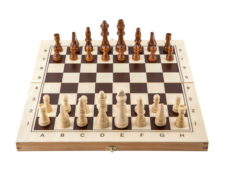 Chess board with chess wooden pieces isolated on white