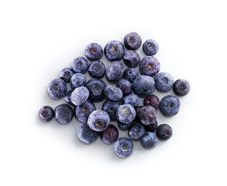 Bowl of frozen domestic blueberries isolated on white background Standard-Bild