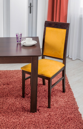 dinning table: Simple wooden dinning table and chair in interior