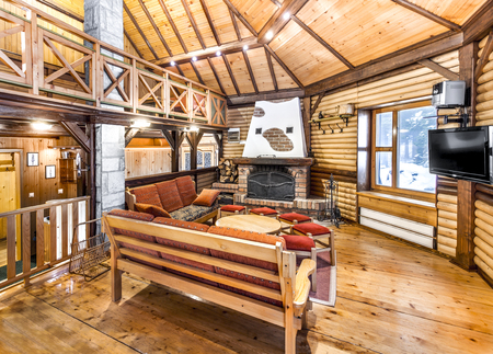 ski lodge: Traditional wooden interior with table and fixtures - mountain resort Editorial
