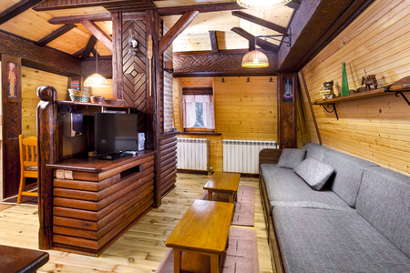 Traditional wooden interior with table and fixtures - mountain resort Editorial