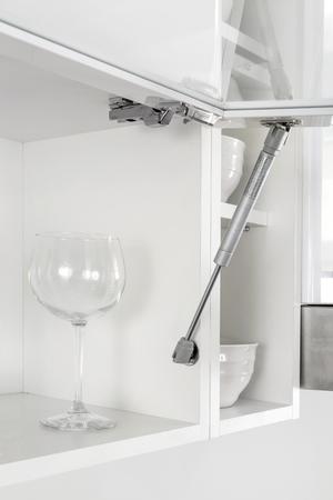 Kitchen front door lift pneumatic or gas support spring. Standard-Bild