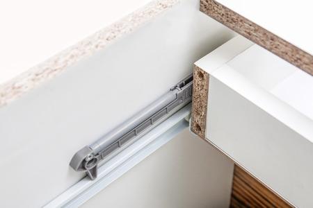 furniture hardware: Undermount Drawer Slides - glides closeup detail. Stock Photo