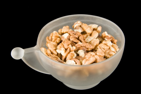 Cup of walnuts Stock Photo - 9136760