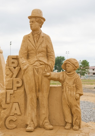 BURGAS, BULGARIA - JULY 2011:Charles Chaplin and th kid on the Sand Sculptures festival in Burgas.The participants are from eight countries: Russia, Ukraine, Latvia, Poland, Bulgaria, Czech Republic, Australia. Stock Photo - 11306006