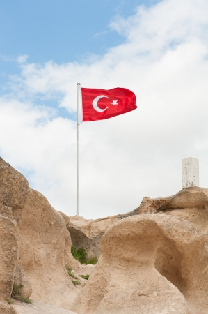 Tukish flag on the top of the fortress of Uchisar photo