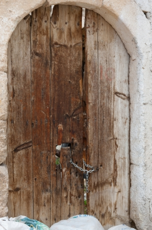 A door in an abandoned house in Uchisar, Cappadocia photo