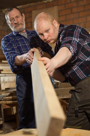 master transmits their skills in woodworking apprentice