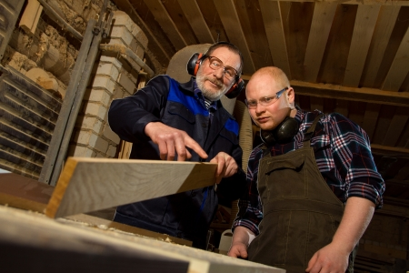 master transmits their skills in woodworking apprentice photo