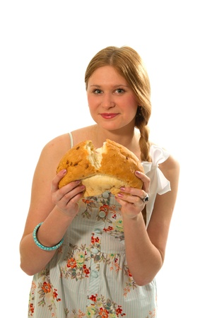 Young beautiful girl in sundress holding bread