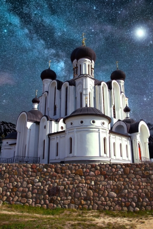 Church painted with all the icons at night under the light of the star of Bethlehem photo