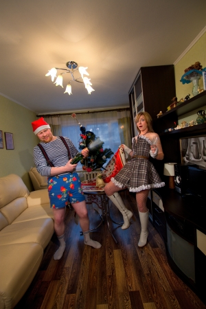 young couple losers in funny costumes to celebrate New Year and Christmas photo