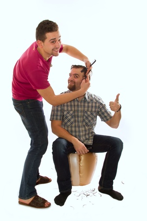 hair stylist makes a man with a beard