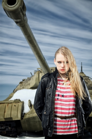 brutal girl stands amid battle tank Stock Photo - 18626684