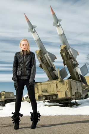 brutal girl standing on a background of military ballistic missiles Stock Photo - 18663907