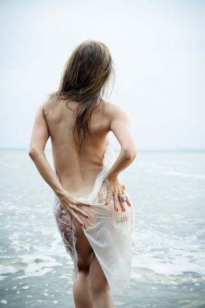 sexy girl with a figure standing at the sea showing her ass Stock Photo