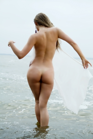 young bikini: sexy girl with a figure standing at the sea showing her ass Stock Photo