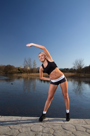 Girl doing exercises on the River photo