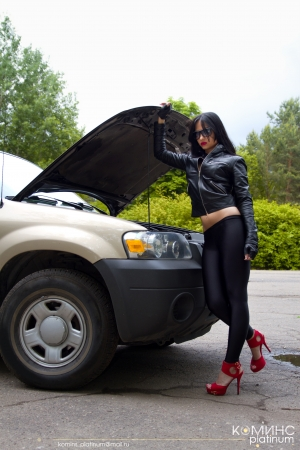 ass standing: girl in the forest opened the cars hood Stock Photo