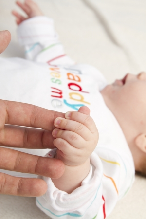 baby hand in hand loving dad photo