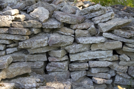 stones stacked pile and form a textured wall photo