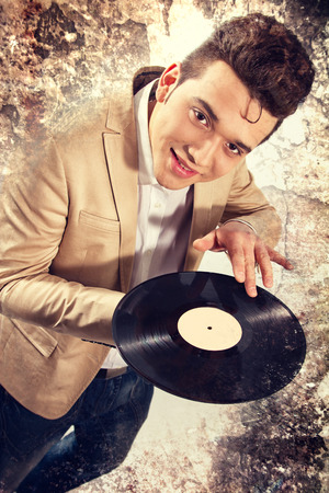 elvis presley: man is very similar to the King of Rock and Roll Elvis Presley Stock Photo