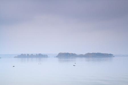 fog over the sea and the island