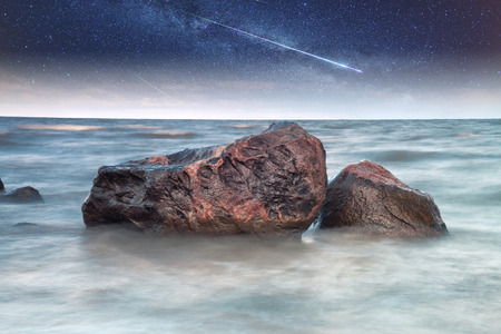 rocks into the sea.  photo
