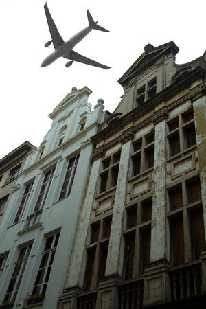 plane over the city of Brussels tilt - shift  photo