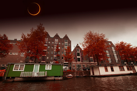 Solar Eclipse over the city Amsterdam.  photo