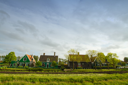 zaan: rural dutch scenery of small old houses and canal in Zaanse, Netherlands