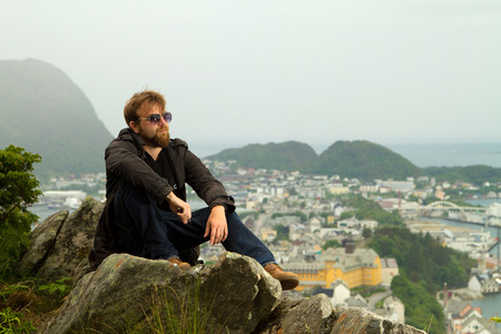 man in Geiranger. beautiful places in Europe photo