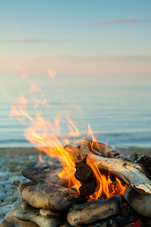 Inviting campfire on the beach during the summer Stok Fotoğraf