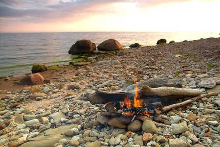 Inviting campfire on the beach during the summer photo