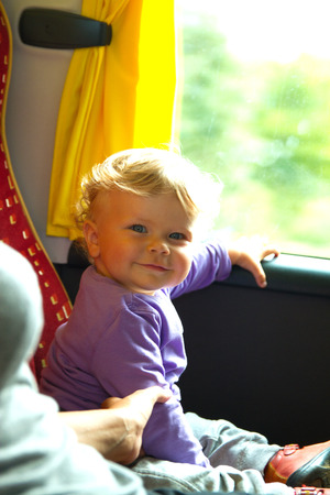 baby girl on a bus photo