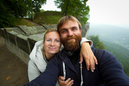 In love couple in Koenigstein . A man and a woman in a wedding trip to Europe in the fall.