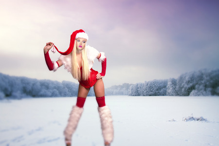 winter's tale: sexy woman in the role of Santa Claus. Winters Tale. wood and the Stock Photo