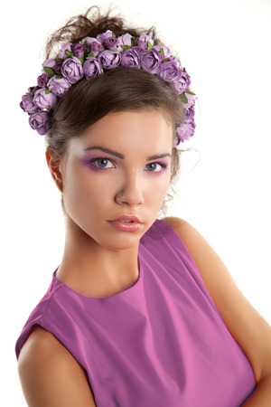 circlet: Beautiful young girl with a floral ornament in her hair Stock Photo
