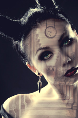 alchemical: demon girl watches. Mystical image of time. Alchemical processes of aging. Photo with double exposure Stock Photo