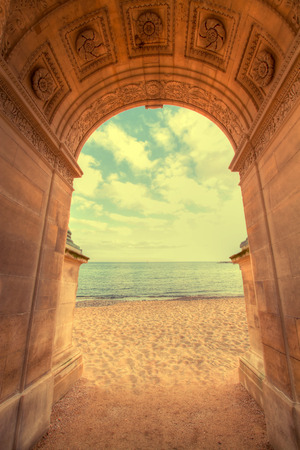 overlooking: door to a vineyard overlooking the sea. vintage photo Stock Photo