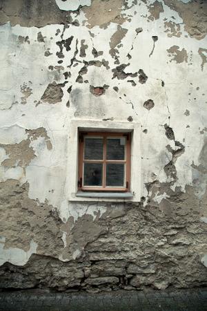 devastation: Vintage window in an old house. European city Stock Photo